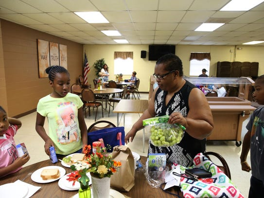 Brandi Leland makes lunch for four of her kids at Dawson