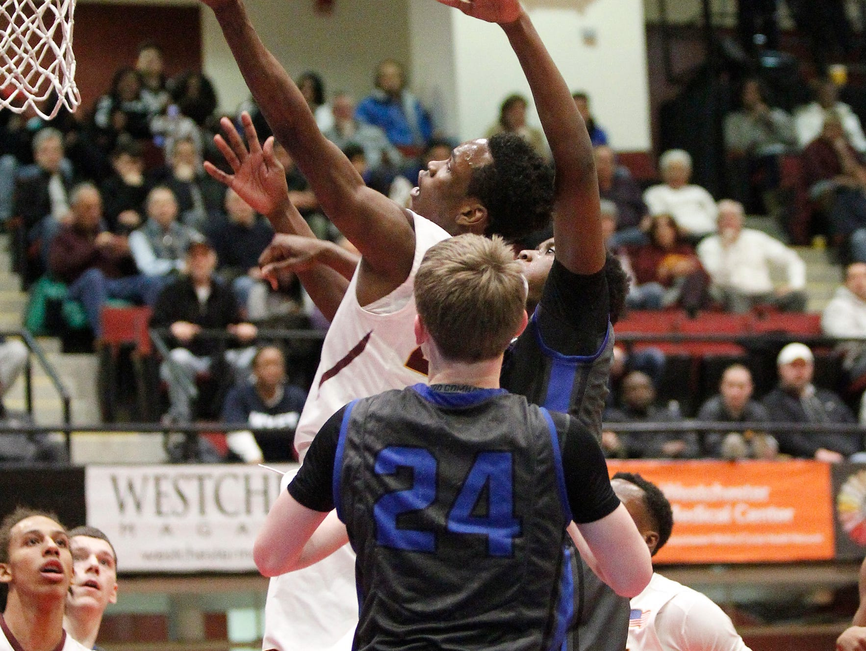 Mount Vernon's Marco Morency (20) works a lay-up during the boys Class AA semi-final basketball game aainst Saunders at the County Center in White Plains on Friday, February 26, 2016.