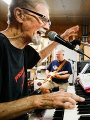 Band members Larry Palmiter, left, of Charlotte, and
