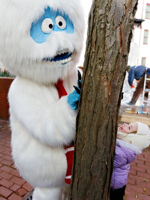 The Yeti or Abominable Snowman, left, plays with Carolina Raschke, 5, of Manchester Township, during FestivICE 2018 in York City, Saturday, Jan. 13, 2018. The festival , created by Eventive, the event planning and production division of York Revolution, is in its fourth year. Dawn J. Sagert photo