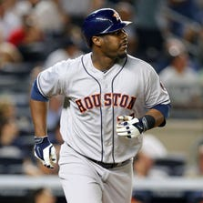 Aug 19, 2014; Bronx, NY, USA; Houston Astros designated hitter Chris Carter (23) hits a three-run home run against the New York Yankees during the ninth inning of a game at Yankee Stadium. Mandatory Credit: Brad Penner-USA TODAY Sports