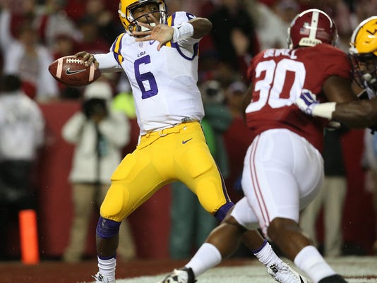 LSU quarterback Brandon Harris (6) prepares to pass the ball as Alabama linebacker Denzel Devall (30) tries to get in to the pocket in the first half of an NCAA college football game Saturday, Nov. 7, 2015, in Tuscaloosa , Ala. (AP Photo/John Bazemore)