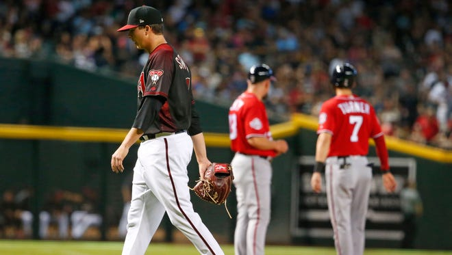 Arizona Diamondbacks starting pitcher Troy Scribner (41) is pulled during the fourth inning of a  MLB game against the Washington Nationals at Chase Field in Phoenix, Az., on May 12, 2018.