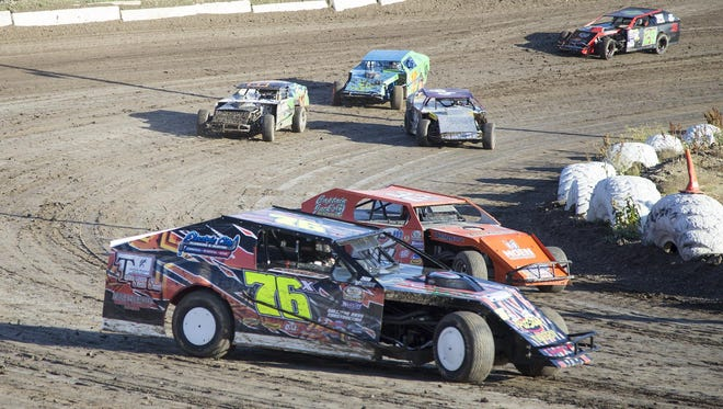Doug LaPierre (76) of Great Falls, races around the second turn during the first heat of the Midwest Modifieds race at Electric City Speedway on Sunday.