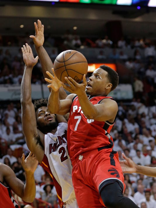 Toronto Raptors' Kyle Lowry (7) goes to the basket against Miami Heat's Justise Winslow during the first half of Game 6 of the NBA basketball Eastern Conference semifinals, Friday, May 13, 2016, in Miami. (AP Photo/Alan Diaz)