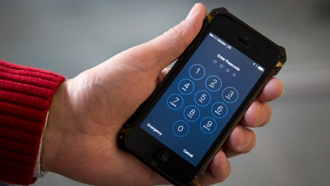 FILE - In this Feb. 17, 2016 file photo, an iPhone is seen in Washington. The FBI's announcement that it mysteriously hacked into an iPhone is a setback for Apple and increases pressure on the technology company to restore the security of its flagship product.  (AP Photo/Carolyn Kaster, File)