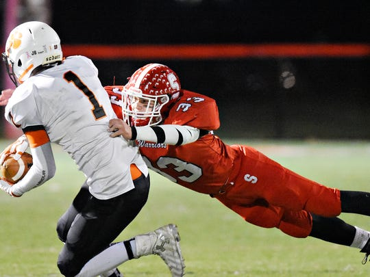 Susquehannock's Allen Clapp, right, dives for East Pennsboro's Nic Nugent during District 3, Class 4-A quarterfinal game action at Susquehannock High School in Shrewsbury Township, Friday, Nov. 10, 2017. The Warriors host York Catholic Friday. Dawn J. Sagert photo