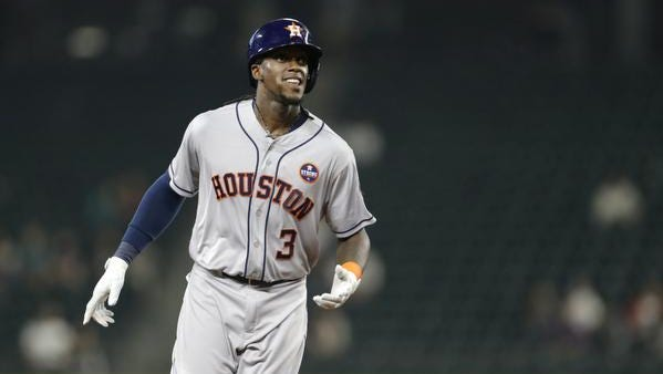 Cameron Maybin, shown last season while playing with the eventual World Series champion Houston Astros, has rejoined the Miami Marlins.