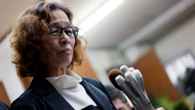 Junko Ishido, the mother of Kenji Goto, a Japanese journalist held by the Islamic State, speaks to reporters at her home in Tokyo on Sunday after the group announced in a video it has beheaded Kenji Goto.
