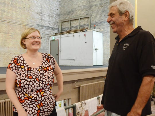 Elizabeth Schultheiss, executive director of the Albion Community Foundation, talks with Jim Cascarelli of Cascarelli's Restaurant inside the Bohm Theatre.