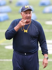 Michigan defensive line coach Greg Mattison works with high school players during the Michigan Football Elite Camp on June 23, 2017.