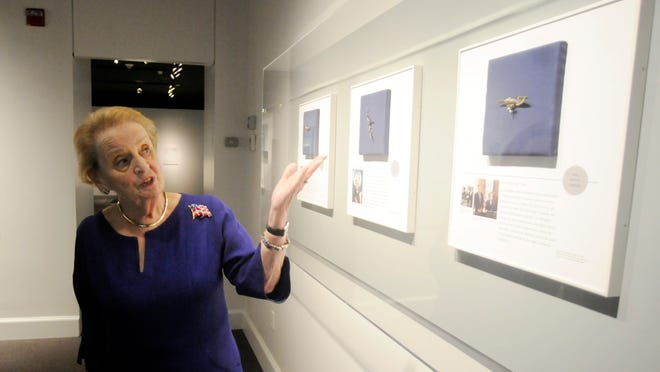 Former Secretary of State Madeleine Albright takes visitors on a tour of her pin collection on Thursday at the Franklin D. Roosevelt Presidential Library and Museum in Hyde Park.