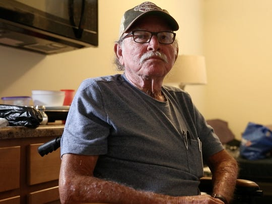 Russell Wallace sits in his room at the Westgate Community Friday, Dec. 1, 2017. Wallace is one of the first new residents of The Dwellings, a tiny home community.