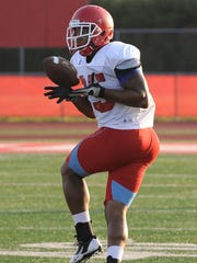 Delaware State fullback/tight end Nagee Jackson catches a pass during practice Saturday morning in Dover.