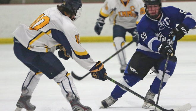 Waukesha senior Ian Malcolmson (right), shown here  competing as a sophomore, is the Wisconsin Hockey Coaches Association state player of the year.
