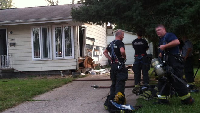 Firefighters investigate after an apparent explosion at a house on Des Moines' south side Friday night.