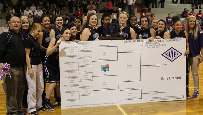 University Academy coach Craig Whittington (far left) guided the Lady Lions to the MAIS Class 1A title Feb. 21 in Learned, Mississippi, after defeating The Veritas School (Miss.), 47-46, in the finals.