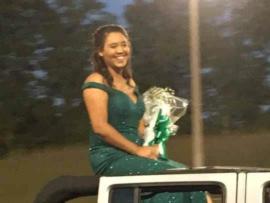 Senior Attendant Aydriona Turner is presented to those