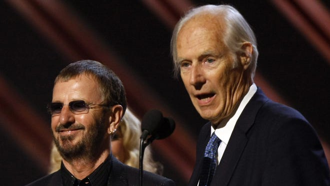 Former Beatles member Ringo Starr and producer George Martin giving an acceptance speech after receiving the trophy for Best Compilation Soundtrack Album at the 50th Grammy Awards in Los Angeles.