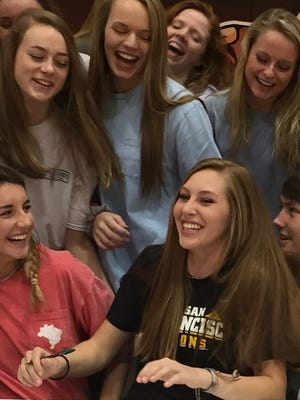 Mauldin senior Ella Reames, front center, shares a laugh with friends during the school's signing ceremony Wednesday in the gymnasium. Reames signed to play beach volleyball at the University of San Francisco.