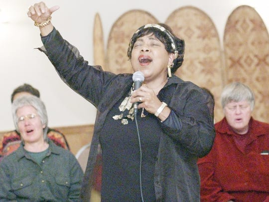 Dorothy Cotton leads the congregation in song during the 2002 Burning Bowl Ceremony at the Foundation of Light on Turkey Hill Road in the Town of Dryden.