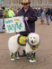 Doggie Duchess Daisy Mae and her handler at last year's Krewe of PAWS annual Mardi Gras Pet Parade in Downtown West Monroe.