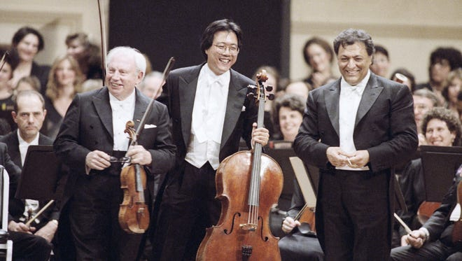 Violinist Isaac Stern, left, cellist Yo-Yo Ma, center and conductor Zubin Mehta respond to the applause of the crowd at Carnegie Hall''s Centennial Gala Evening Concert in New York on Sunday, May 6, 1991.