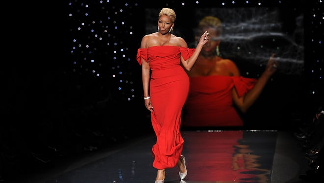 Actress and TV personality NeNe Leakes models an outfit from the 2014 Red Dress Collection in New York on Feb 6, 2014.
