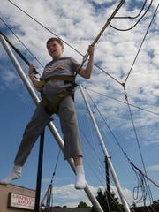 Ryan Maki, 10, enjoyed a harness bounce ride at the