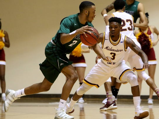 Midwestern State's Devante Pullum guards Eastern New