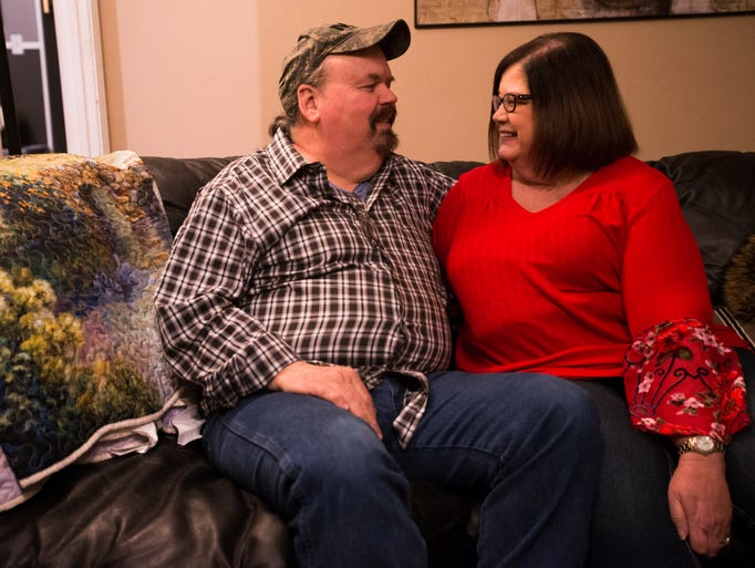 Renea and Mike Rosson smile at each other in their