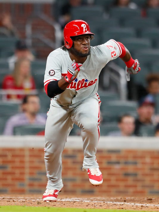 Philadelphia Phillies' Odubel Herrera runs to first on a double in the ninth inning of the team's baseball game against the Atlanta Braves, Wednesday, June 7, 2017, in Atlanta. The Braves won 14-1. (AP Photo/Todd Kirkland)