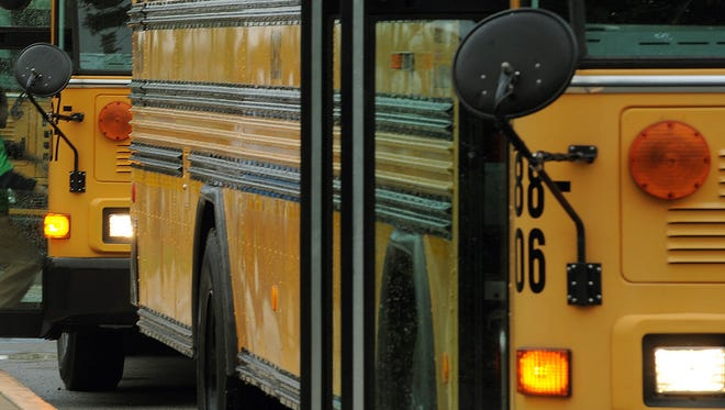 Students from Bunker Hill Elementary walk out to their assigned buses following school Franklin Township in 2011.
