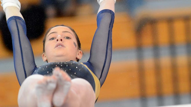 Woodstock Academy's Jenna Davidson performs on the uneven bars at the 2019 New England Gymnastics Championship in Hudson, Mass.