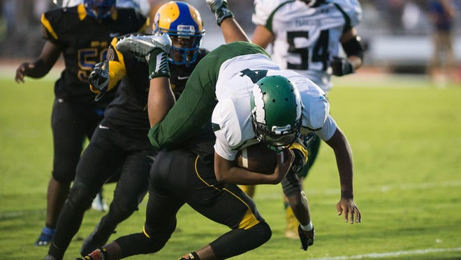 Parkside's Dajour Church (4) makes a diving play at the goal line.