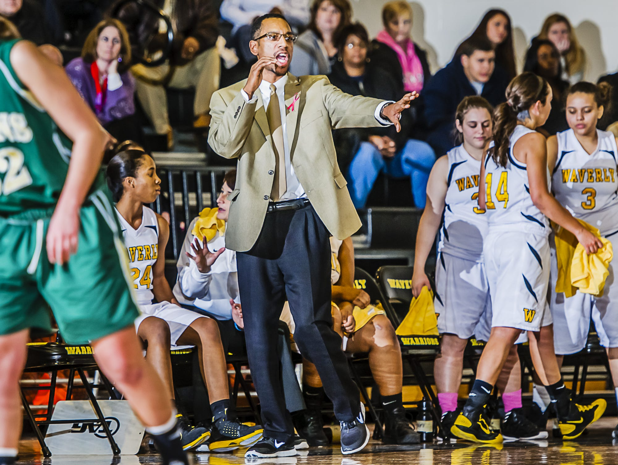 T.J. Hawkins directs the Waverly girls basketball team as they take on Lumen Christi in 2013.
