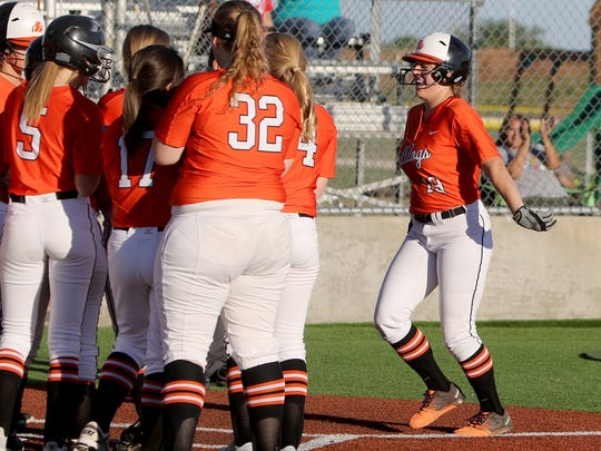 Burkburnett's Faith Hollingsworth is met at home by her teammates after hitting a homerun in the game against Hirschi Monday, March 27, 2017, at Sunrise Optimist Field 2. The Lady Bulldogs defeated the Lady Huskies 16-1.