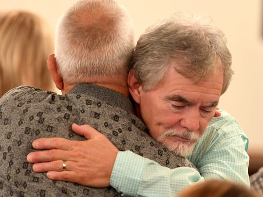 Dana Bobo receives a hug from a supporter after recess