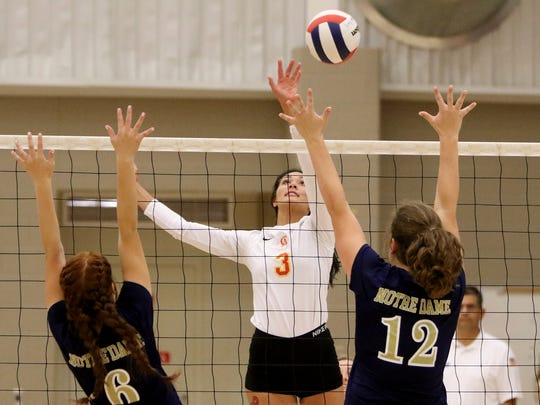 Christ Academy's Kelsey McClellan hits the ball over