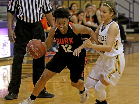 Burkburnett's Carolyn Thomas dribbles by Stephenville's Madison Carter Thursday, Feb. 15, 2018, in the Region I-4A Area Championship in Jacksboro.