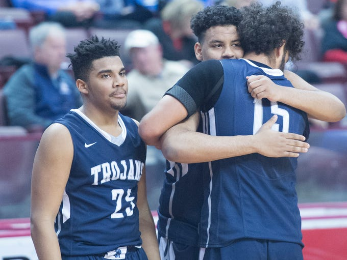 Players Tyler Collier (15) and Joel Torres congratulate