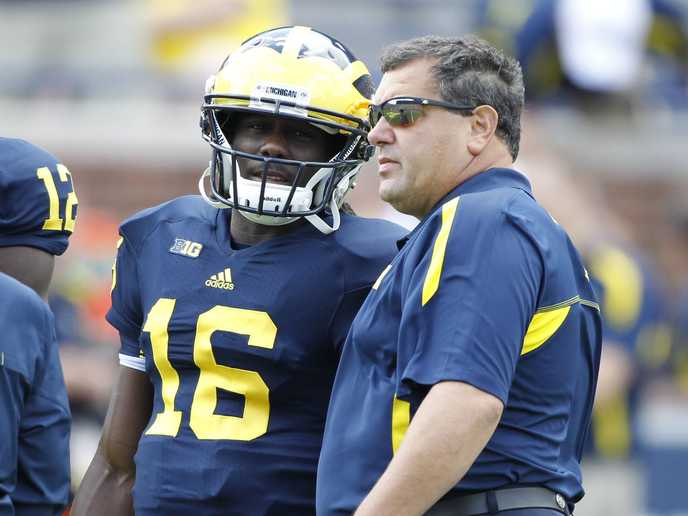 Denard Robinson talks with Brady Hoke during a game in Sept. 2012.