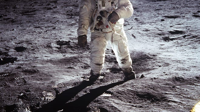 """Astronaut Buzz Aldrin, lunar module pilot, walks on the surface of the Moon near the leg of the lunar module """"Eagle"""" during the Apollo 11 extravehicular activity. Astronaut Neil A. Armstrong, commander, took this photograph with a 70mm lunar surface camera. While astronauts Armstrong and Aldrin descended in the lunar module to explore the Moon's Sea of Tranquility region, astronaut Michael Collins remained with the command and service modules """"Columbia"""" in lunar orbit."""