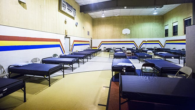 Beds are set up for homeless people looking for a warm place to sleep in the Fond du Lac Salvation Army's  warming shelter. St. Mary's Church is also open days for people to escape frigid temperatures.