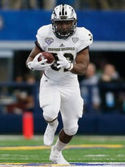 Western Michigan Broncos running back Jamauri Bogan (32) carries the ball in the second quarter against the Wisconsin Badgers at AT&T Stadium.