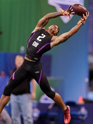 Alabama defensive back Anthony Averett runs a drill at the NFL football scouting combine in Indianapolis, Monday, March 5, 2018. (AP Photo/Michael Conroy)