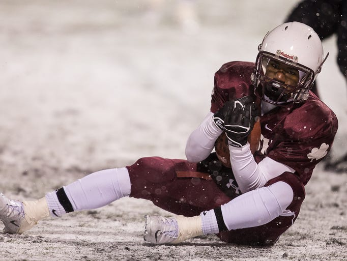 Marcus Conner of Aquinas pulls in a TD in a win over Elmira Saturday.