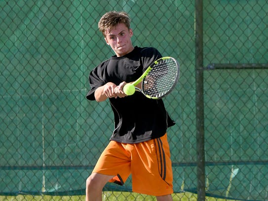 Blake Webster slaps a backhand in his boys 16 title