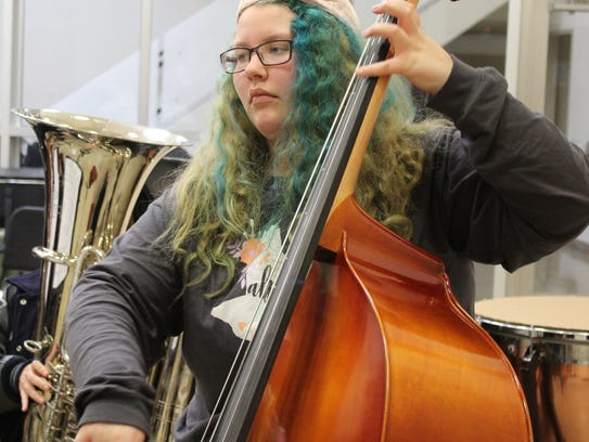 Heather Cairns, of Abilene, plays the double bass during