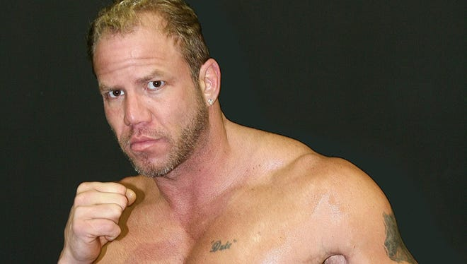 Tommy Morrison, shown in 2007 before one of his final fights in Chester W.Va., died Sunday night. He was 44.